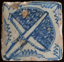 Tile with symbol of wool workers