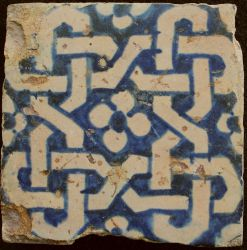 Tile with symmetrical decoration