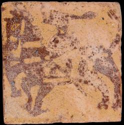 Medieval tile decorated with horseman